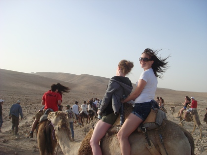 We rode camels in the middle of the desert